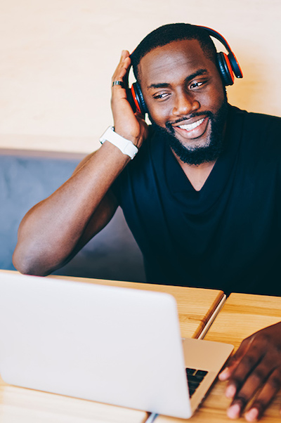 Man sitting at desk with headphones